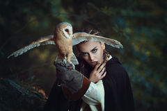Mysterious woman with barn owl Stock Images