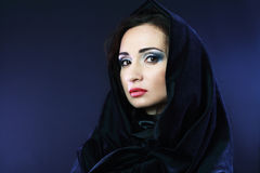 Mysterious woman. Beautiful mysterious woman in black hood evil halloween witch look Royalty Free Stock Photos