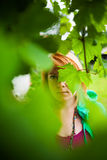 Mysterious woman behind leaves Royalty Free Stock Photo
