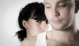 Mysterious woman behind a mans back Stock Images