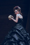 Mysterious woman in black dress Royalty Free Stock Photos