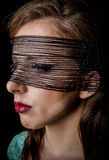 Mysterious Woman with Black net on her Face Royalty Free Stock Photo