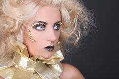 Mysterious woman with blondie shaggy hair and creative makeup Stock Photos