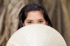 Mysterious Woman Covering Half Face with Fan Royalty Free Stock Photography