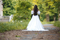 Mysterious woman. Departing off into the distance royalty free stock photos