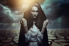 Mysterious woman in a desert landscape royalty free stock photo