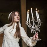 Woman. Mysterious woman in dress with candles Royalty Free Stock Photography