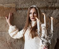 Woman. Mysterious woman in dress with candles Royalty Free Stock Images