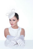 Mysterious Woman in Elegant white Hat and glowes Stock Photography