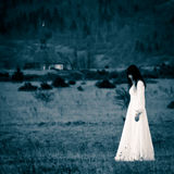 Mysterious woman in the field Royalty Free Stock Images