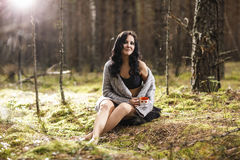 Mysterious woman in the forest Stock Image