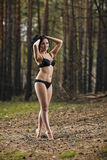 Mysterious woman in the forest Royalty Free Stock Images