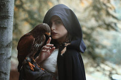 Mysterious woman with hawk. Dark fantasy Royalty Free Stock Images