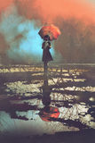 Mysterious woman holds umbrella standing in a puddle. With reflection of spooky forest, illustration painting Royalty Free Stock Images