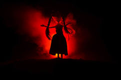 Mysterious Woman, Horror scene of scary ghost doll woman on dark blue background with smoke Stock Images
