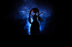 Mysterious Woman, Horror scene of scary ghost doll woman on dark blue background with smoke Royalty Free Stock Image
