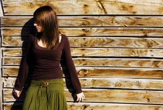 Mysterious Woman In Wooden Wall Stock Photography