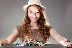 Mysterious woman with jewelry necklaces beads. Stock Photo