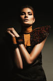 Mysterious woman in leather accessory. In dark Royalty Free Stock Photos