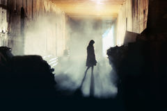 Mysterious Woman. A lone wonan stands in a misty underground tunnel
