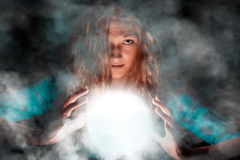 Mysterious woman making some magic royalty free stock photo