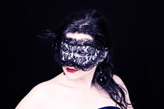 Mysterious woman in mask Royalty Free Stock Image
