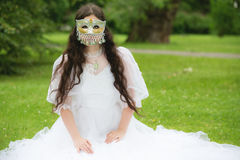 Mysterious woman in mask Stock Photography