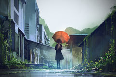 Mysterious woman with orange umbrella. Mysterious woman holds orange umbrella standing on street in abandoned city with digital art style, illustration painting Stock Photography