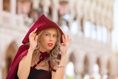 Mysterious woman in red cloak Stock Photo