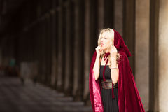 Mysterious woman in red cloak Stock Photography