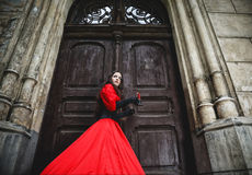 Mysterious woman in red Victorian dress Royalty Free Stock Image