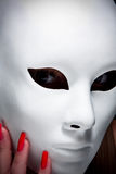 Mysterious woman under mask Royalty Free Stock Photography
