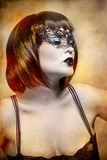 Mysterious woman with Venetian mask Royalty Free Stock Photography