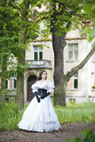 Mysterious woman. In a white Victorian dress stock images