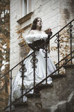 Mysterious woman in a white Victorian dress Stock Photos