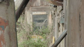 Mysterious Wooden Shed Background. Medium long high dynamic range shallow depth of field tracking slider shot moving towards two in focus wooden planks on both stock video footage