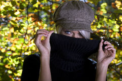 Mysterious young blond woman Stock Images