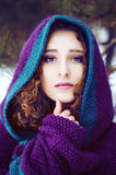 Mysterious young woman in purple cape with a hood Royalty Free Stock Photo