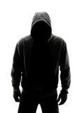 Mysteriöser Mann im Schattenbild Stockfotografie