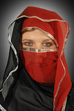 Mystery Arabian. Portrait bellydancer in red chador Royalty Free Stock Image