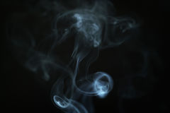 Mystery blue smoke over dark background closeup Royalty Free Stock Photo