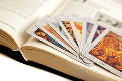 Mystery cards. Ancient old book with mystery cards Stock Images