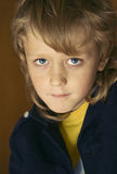 Mystery of childhood. In the blue eyes Stock Photos