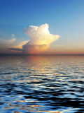 Mystery cloudscape. Beautyful mystery cloudscape and its reflection in the water. Great background Royalty Free Stock Photo