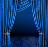 Mystery curtains. Blue curtains framing mysterious dark stage scene stock photography