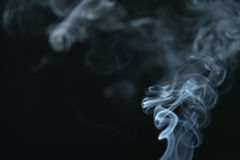Mystery dense blue smoke over dark background. Abstract photo Royalty Free Stock Photography