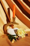 Mystery and desire, symbols. Rose, heart and candle on a golden background, suggesting the desire for love and mystery Stock Photo