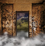 Mystery door. Open door from the inside of a derelict building with smoke covering the floor, looking outside to a mountain landscape Royalty Free Stock Photos
