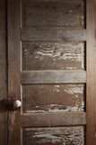Mystery Door. A wooden door with paint chipping off Stock Photos