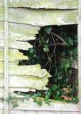 Mystery fence hole. Sports ground off Harrow ring road Royalty Free Stock Photo